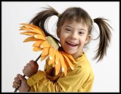 Nena down amb flor